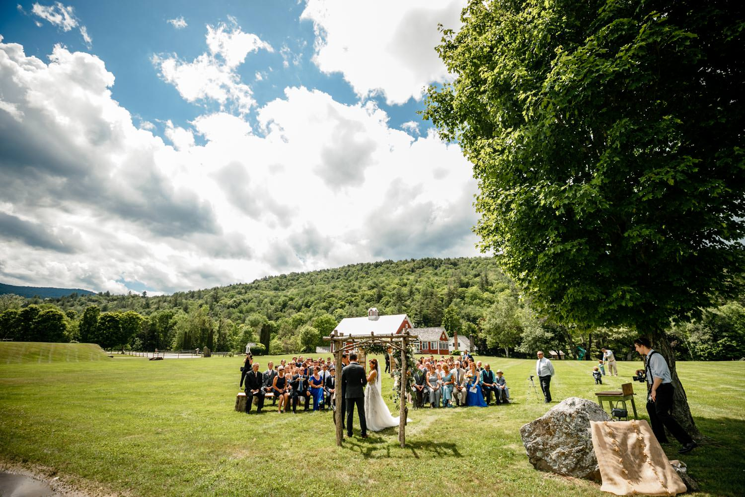 wide angle photographer of wedding ceremony at riverside farm vermont