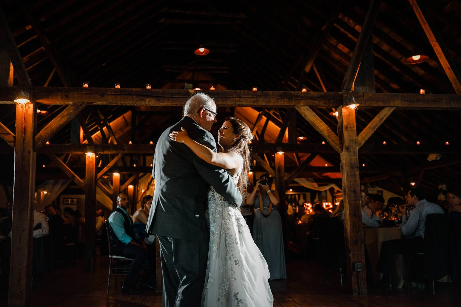 father daughter dance at wedding reception at riverside farm vermont