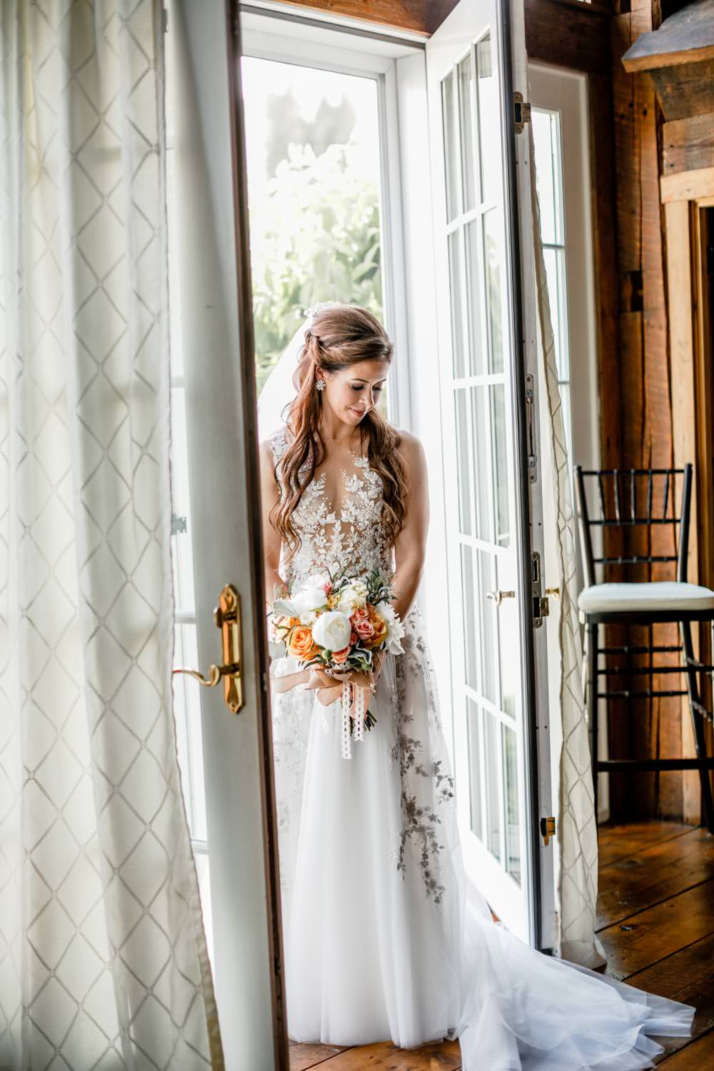 color photographer of bride doorway of wedding suite riverside farm pittsfield vermont