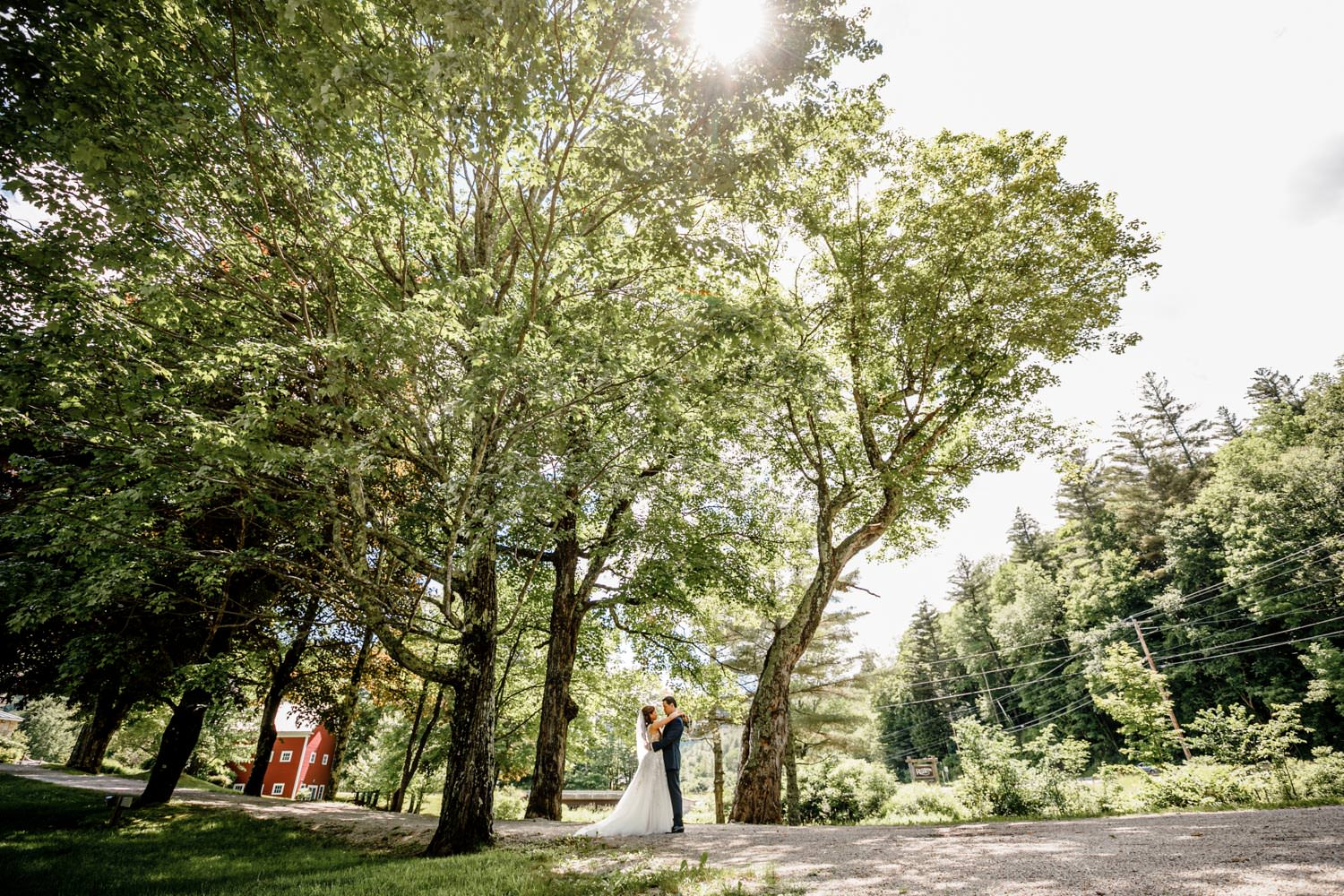 vermont wedding photographer captures first look on road at riverside farm