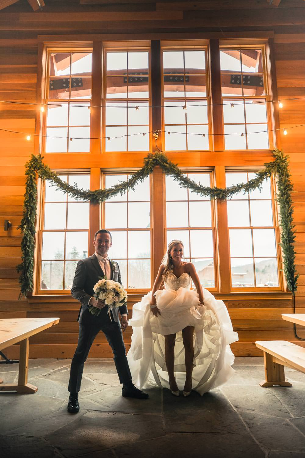 bride and groom stand for wedding photography at Stowe Mountain Lodge Vermont