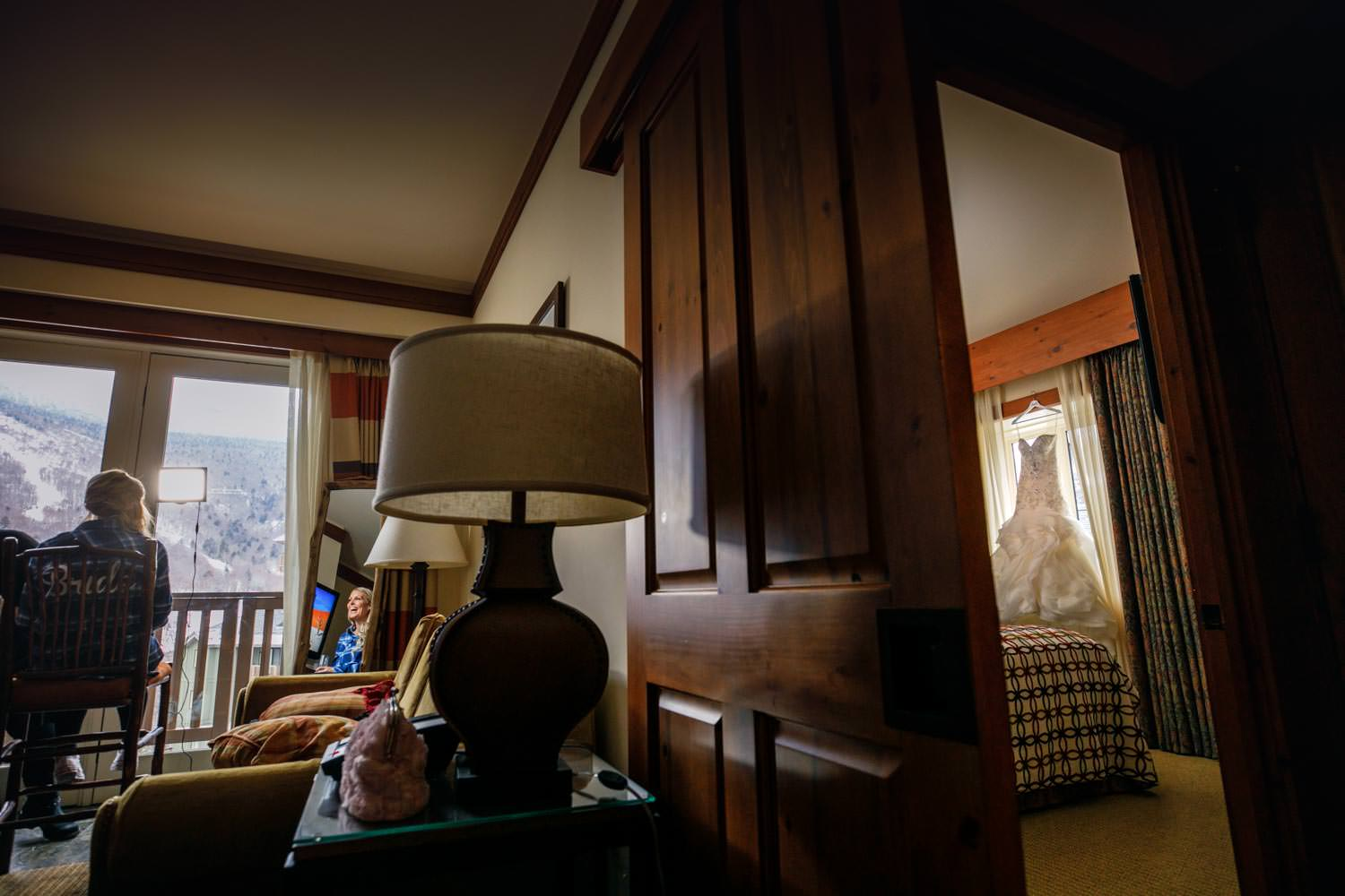 wedding photographer captures brides getting hair and makeup in bridal suite at stowe mountain lodge vt