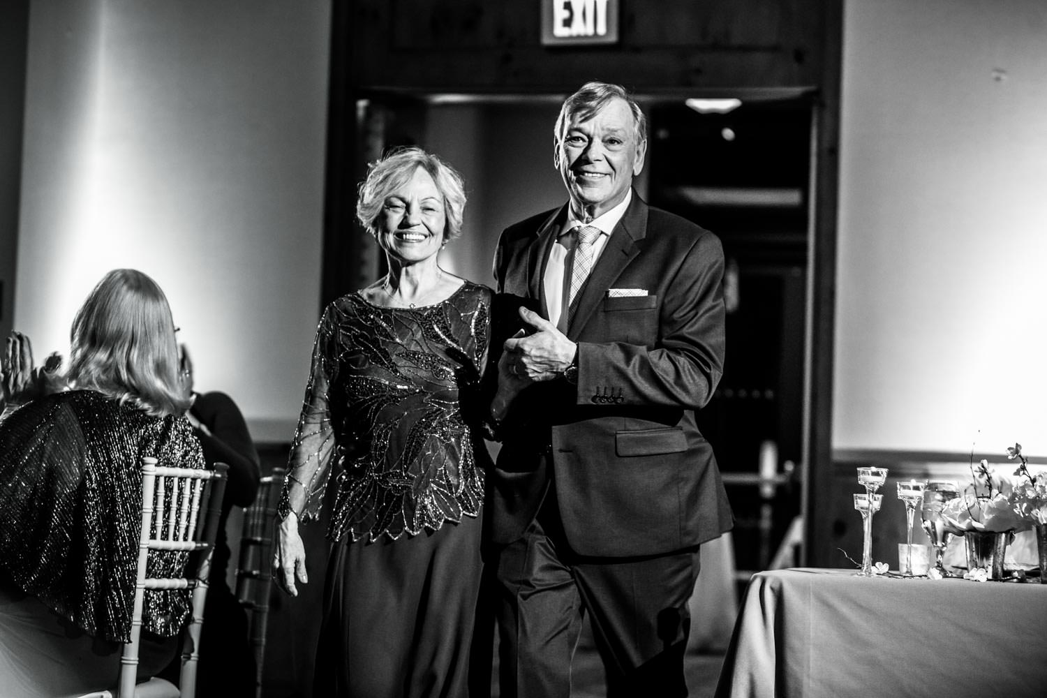 formal introduction of groom's parents at wedding reception in the ballroom of Stowe Mountain Lodge Vermont