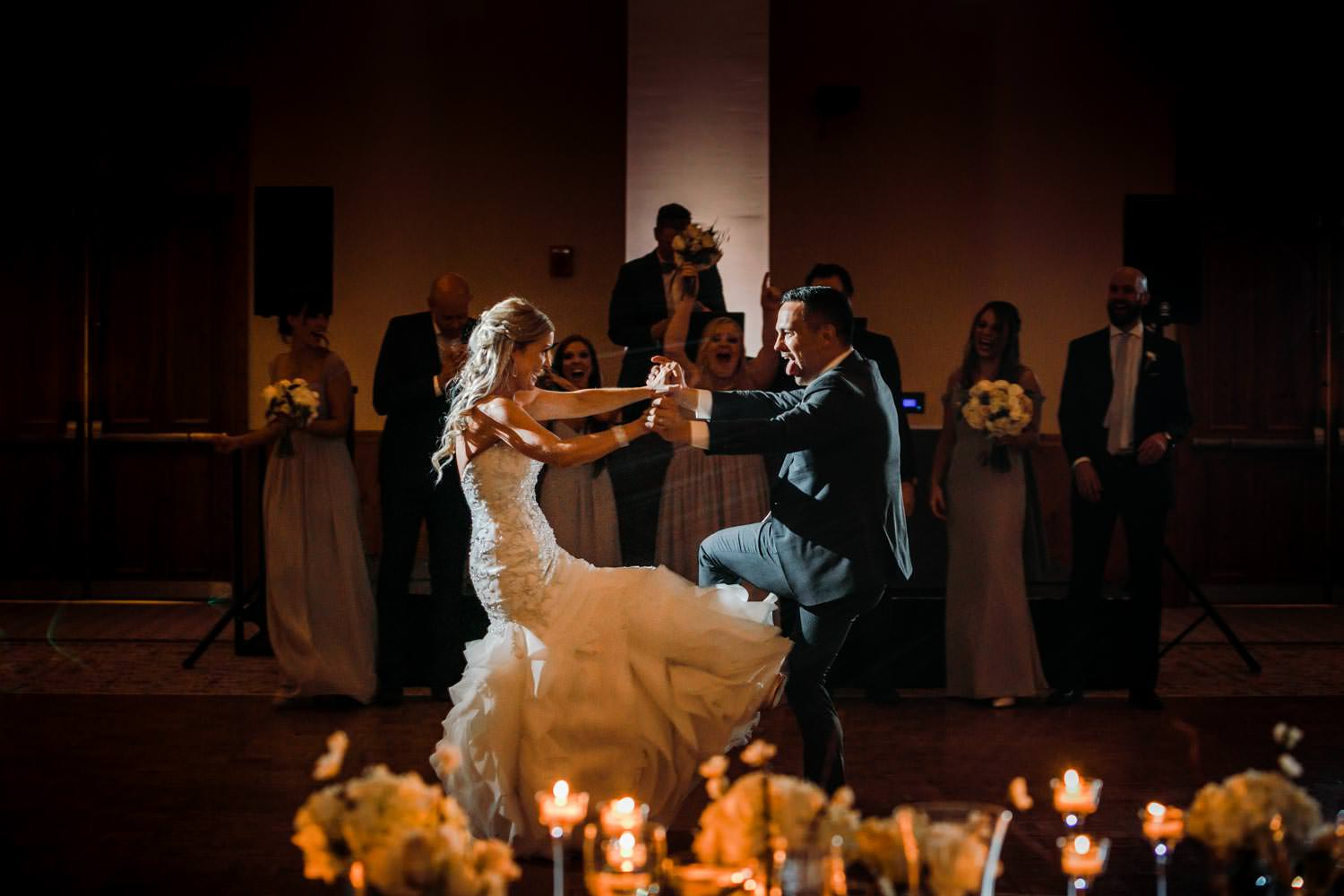 bride and groom facing each other with hands together for first dance in ballroom at Stowe Mountain Lodge