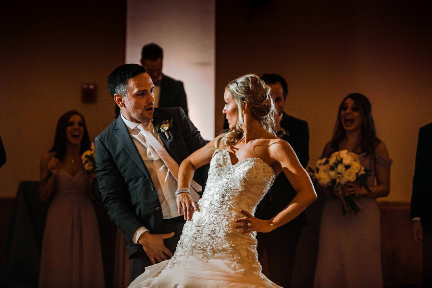 bride and groom looking at each other during wedding reception first dance at Stowe Mountain Lodge