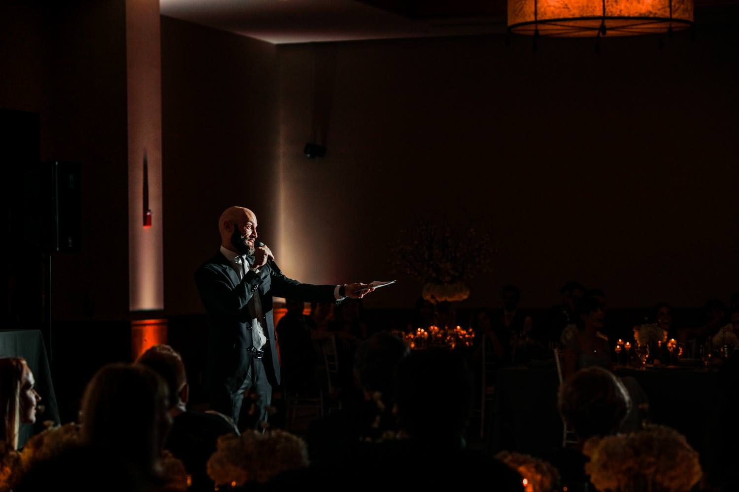best man giving speech in ballroom at Stowe Mountain Lodge Vermont