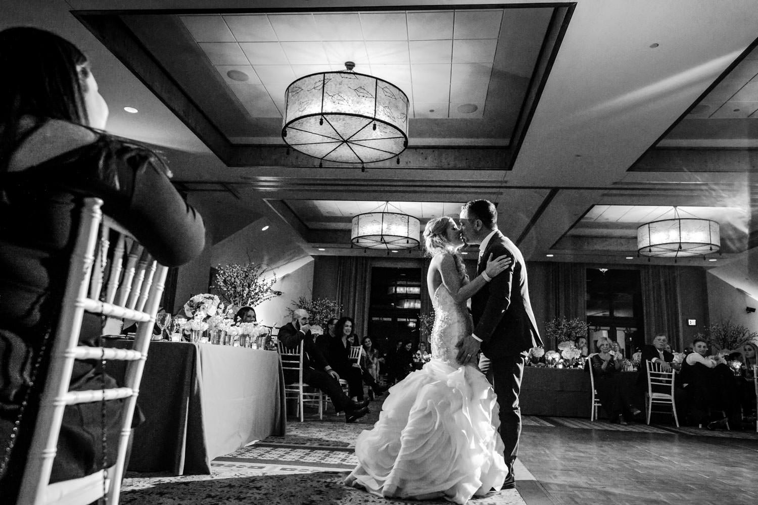 groom kissing bride in reception ballroom at Stowe Mountain Lodge Vermont