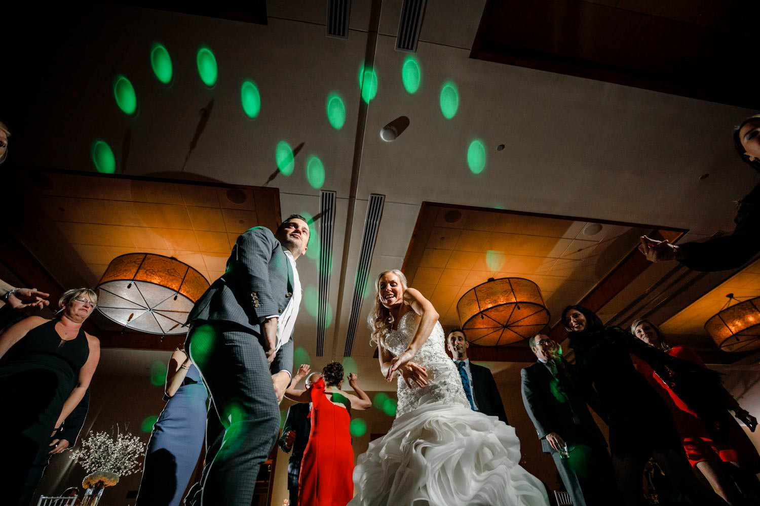 bride and groom dance in front of wedding photographer at Stowe Mountain Lodge Vermont