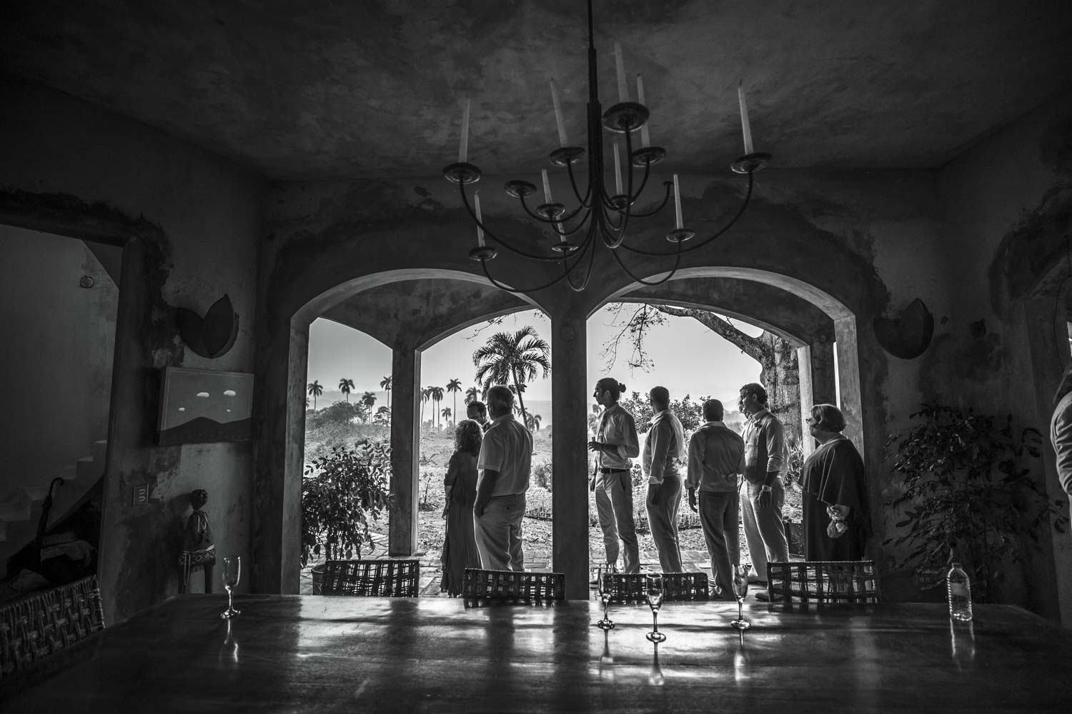 Wedding party stands in arched openings waiting to walk into ceremony at Castle Club in Cabarete Dominican Republic