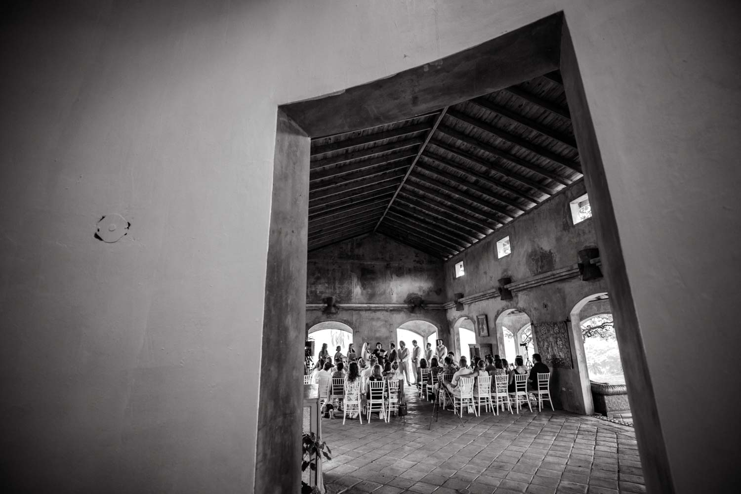 View of wedding ceremony through a doorway at Castle Club in Cabarete Dominican Republic