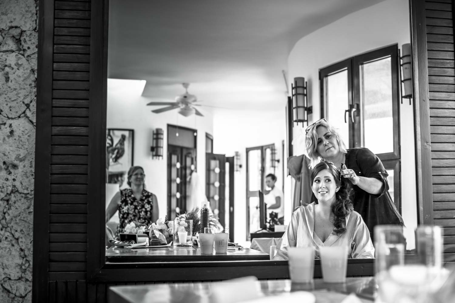 Wedding photographer captures bride looks into the mirror at Hotel Magnifico Cabarete Dominican Republic