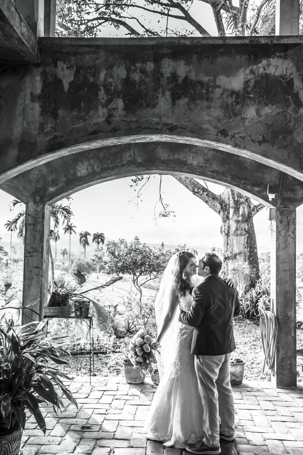Bride and groom kissing directly after their wedding ceremony at Castle Club in Cabarete Dominican Republic