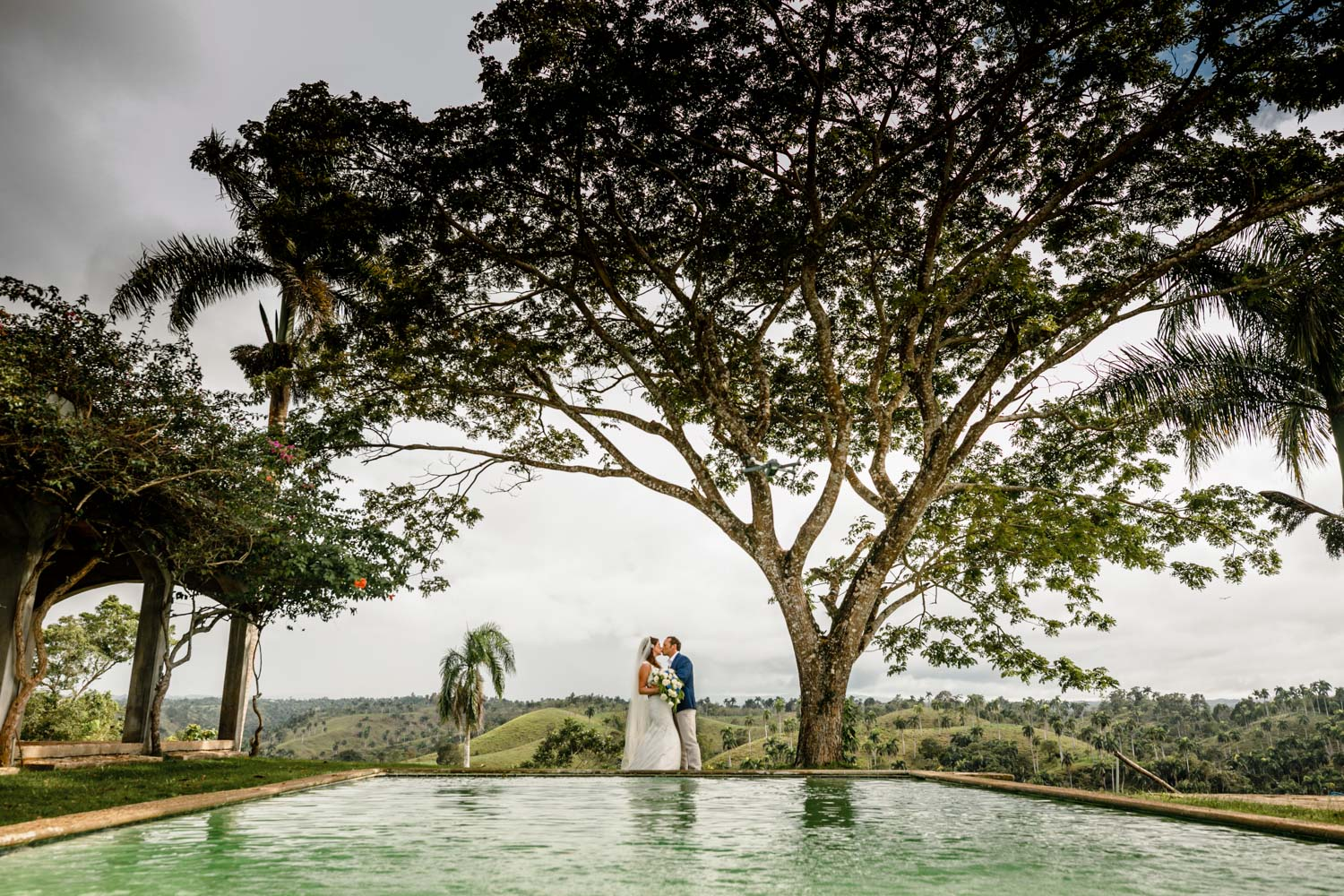 Bride and groom by the pool at Castle Club in Cabarete Dominican Republic after their wedding