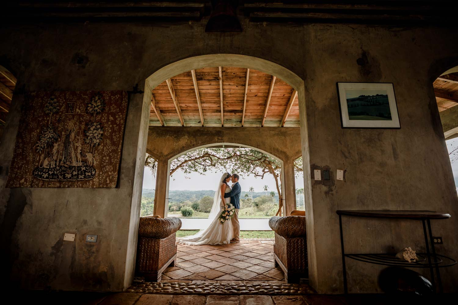 Bride and groom in arched doorway at Castle Club in Cabarete Dominican Republic after their wedding