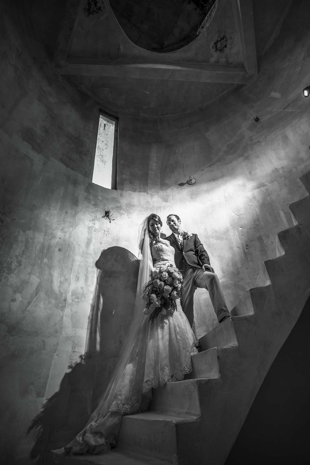 Bride and groom on staircase at Castle Club in Cabarete Dominican Republic after their wedding