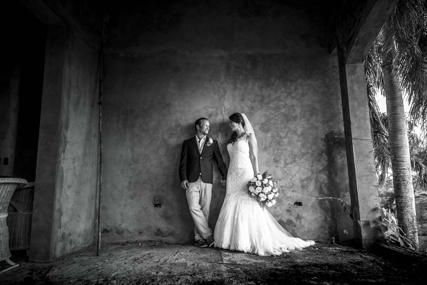 Bride and groom against wall at Castle Club in Cabarete Dominican Republic after their wedding
