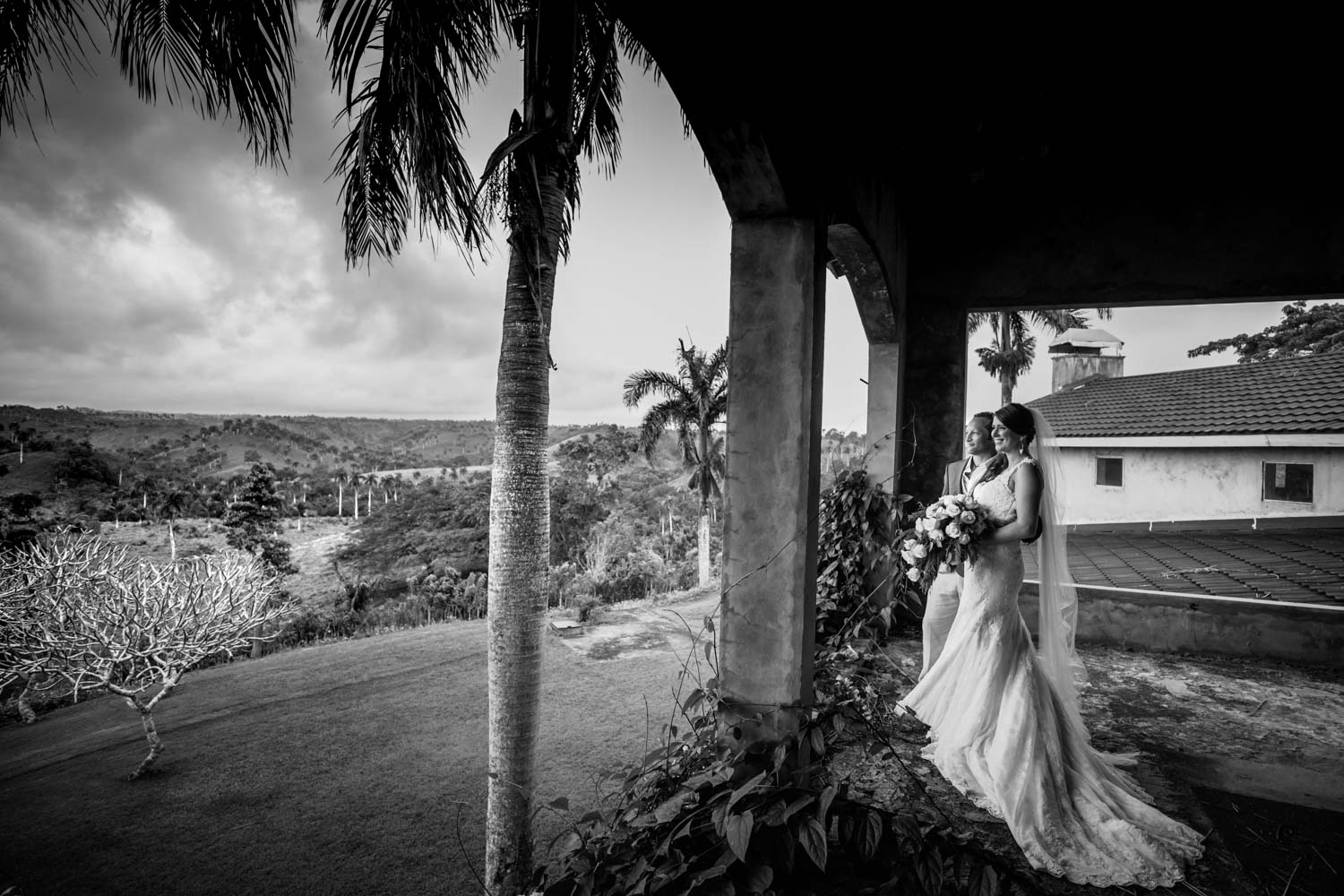 Bride and groom pose for photo at Castle Club in Cabarete Dominican Republic after their wedding