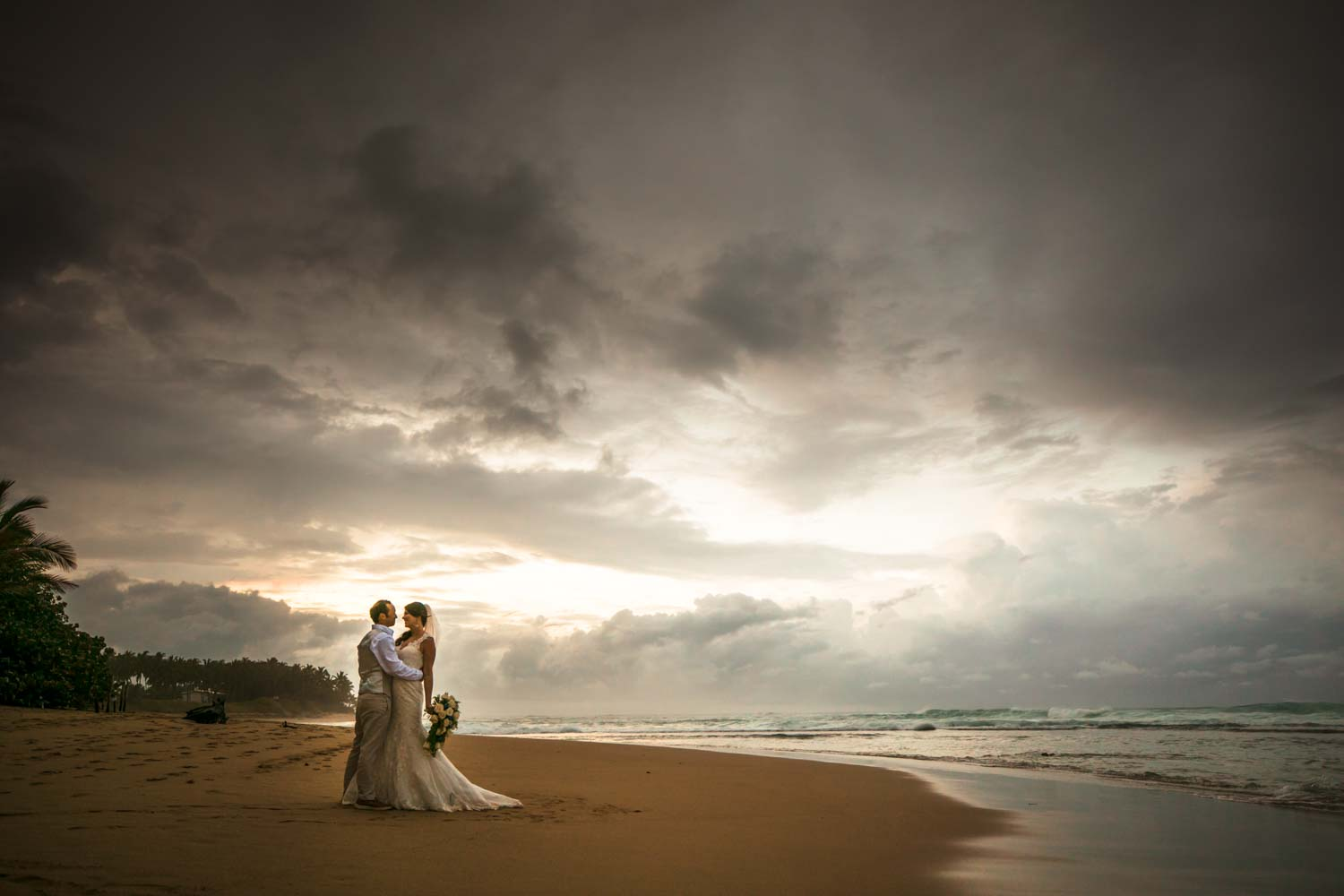 Bride and groom on the beach of the wedding reception at Hideaway Beach Resort in Cabarete Dominican Republic