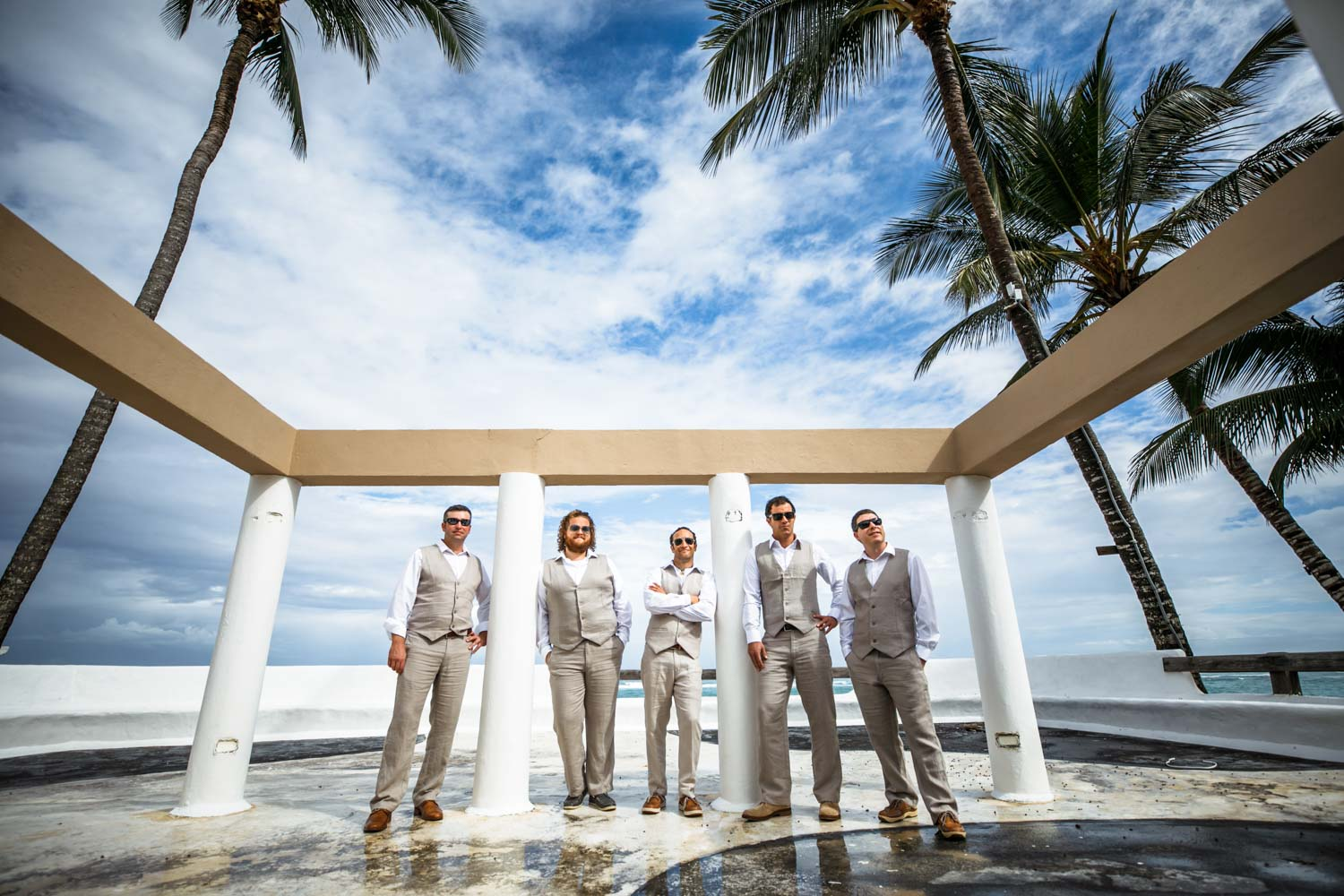 Wedding party stands for photo at Kite Beach Hotel in Cabarete Dominican Republic