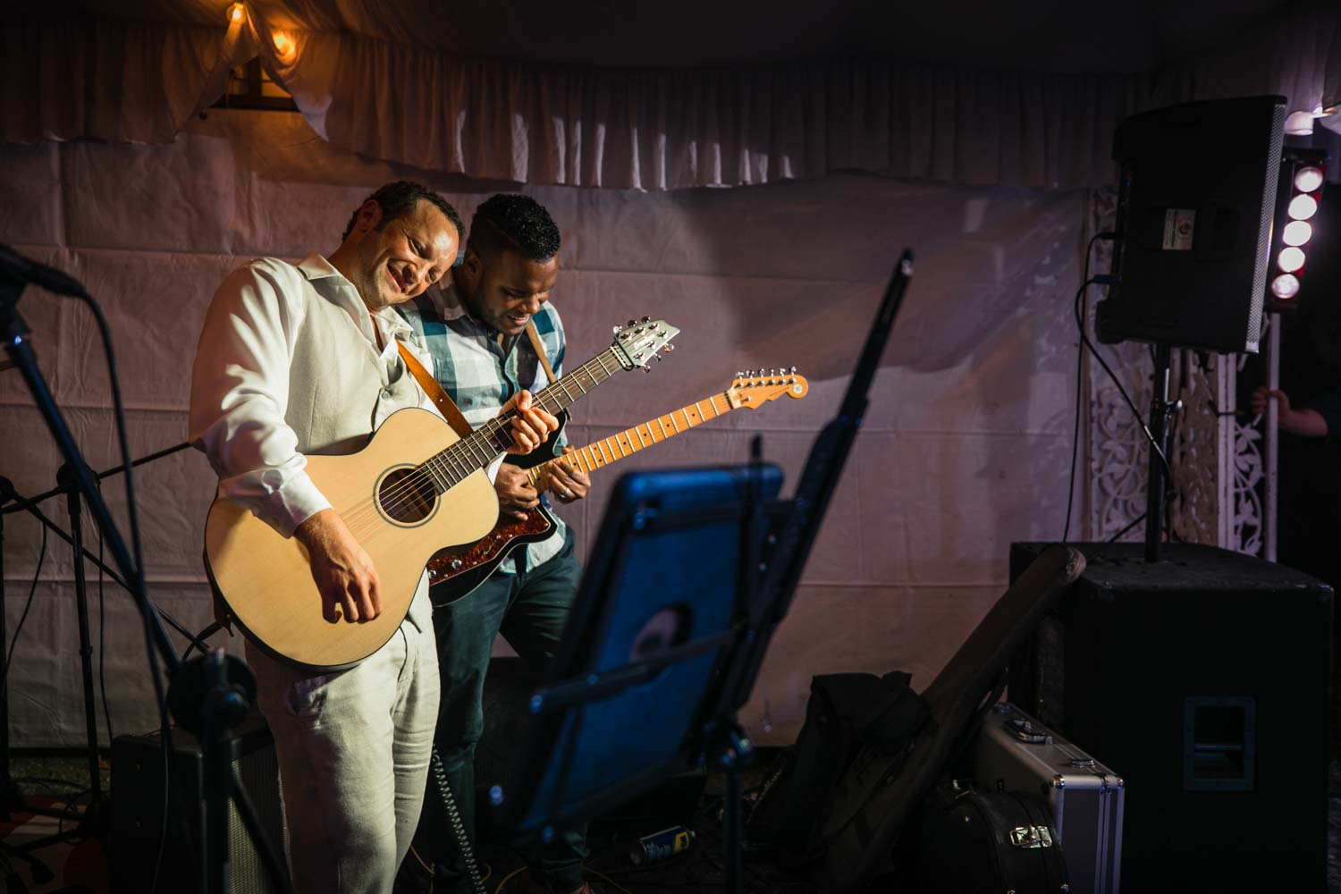 Groom playing guitar with band at Hideaway Beach Resort in Cabarete Dominican Republic