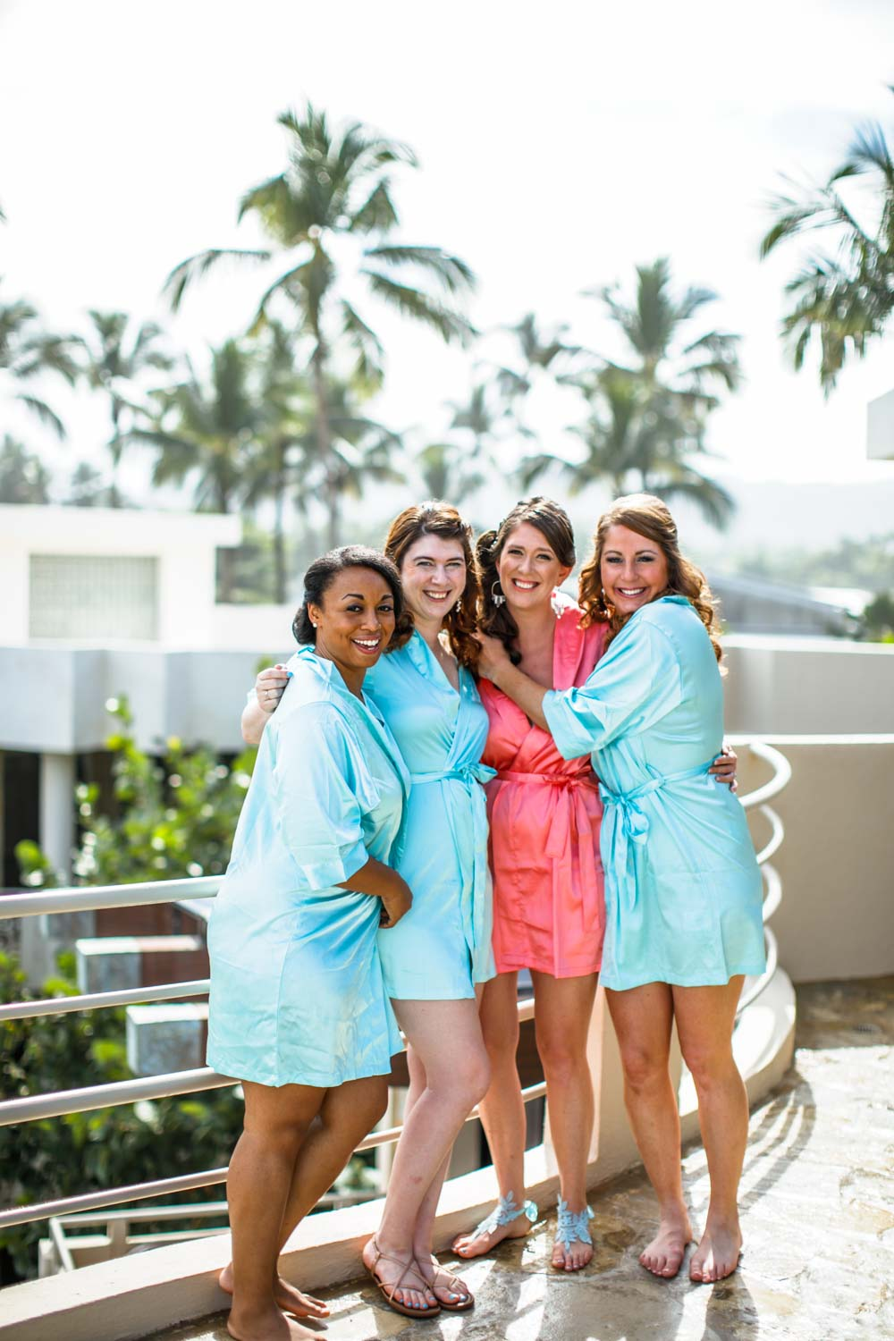 Bridesmaids pose for photographer on roof deck of wedding suite at Hotel Magnifico Cabarete Dominican Republic