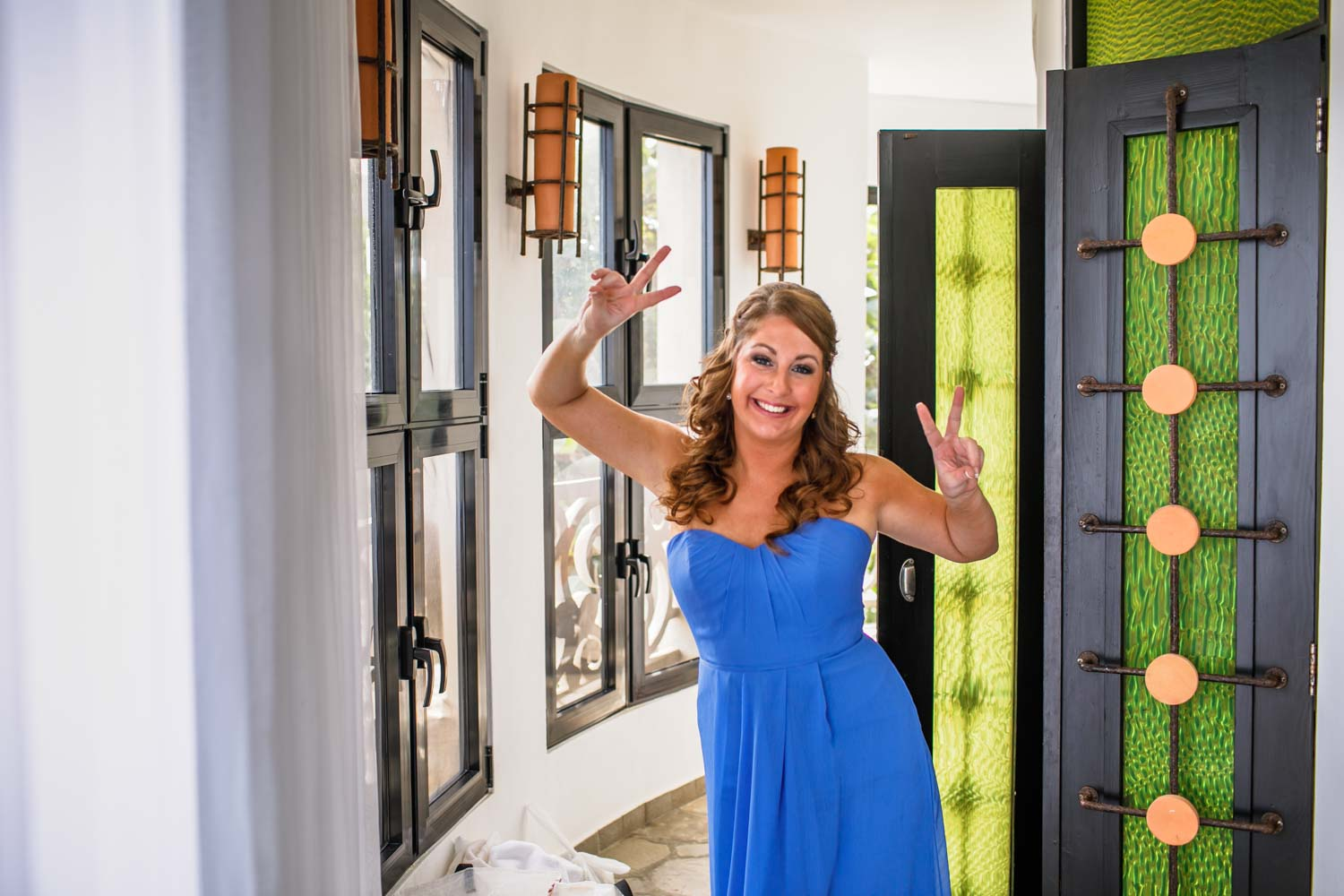 Bridesmaid giving peace signs to photographer in wedding suite at Hotel Magnifico Cabarete Dominican Republic