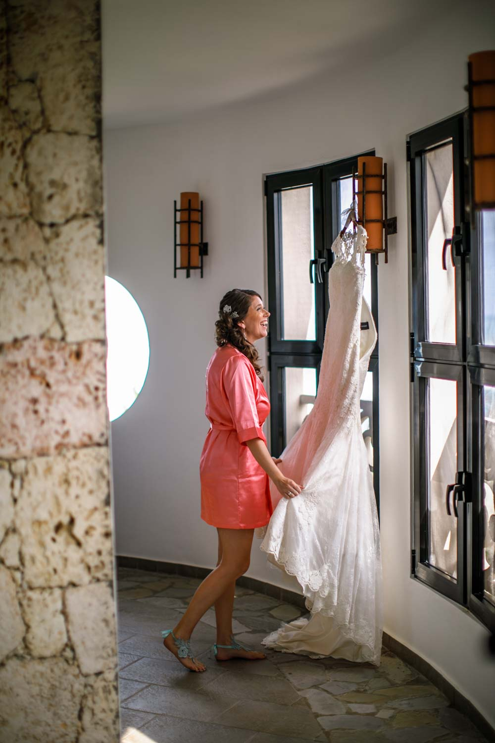Bride looking at dress in wedding suite at Hotel Magnifico Cabarete Dominican Republic