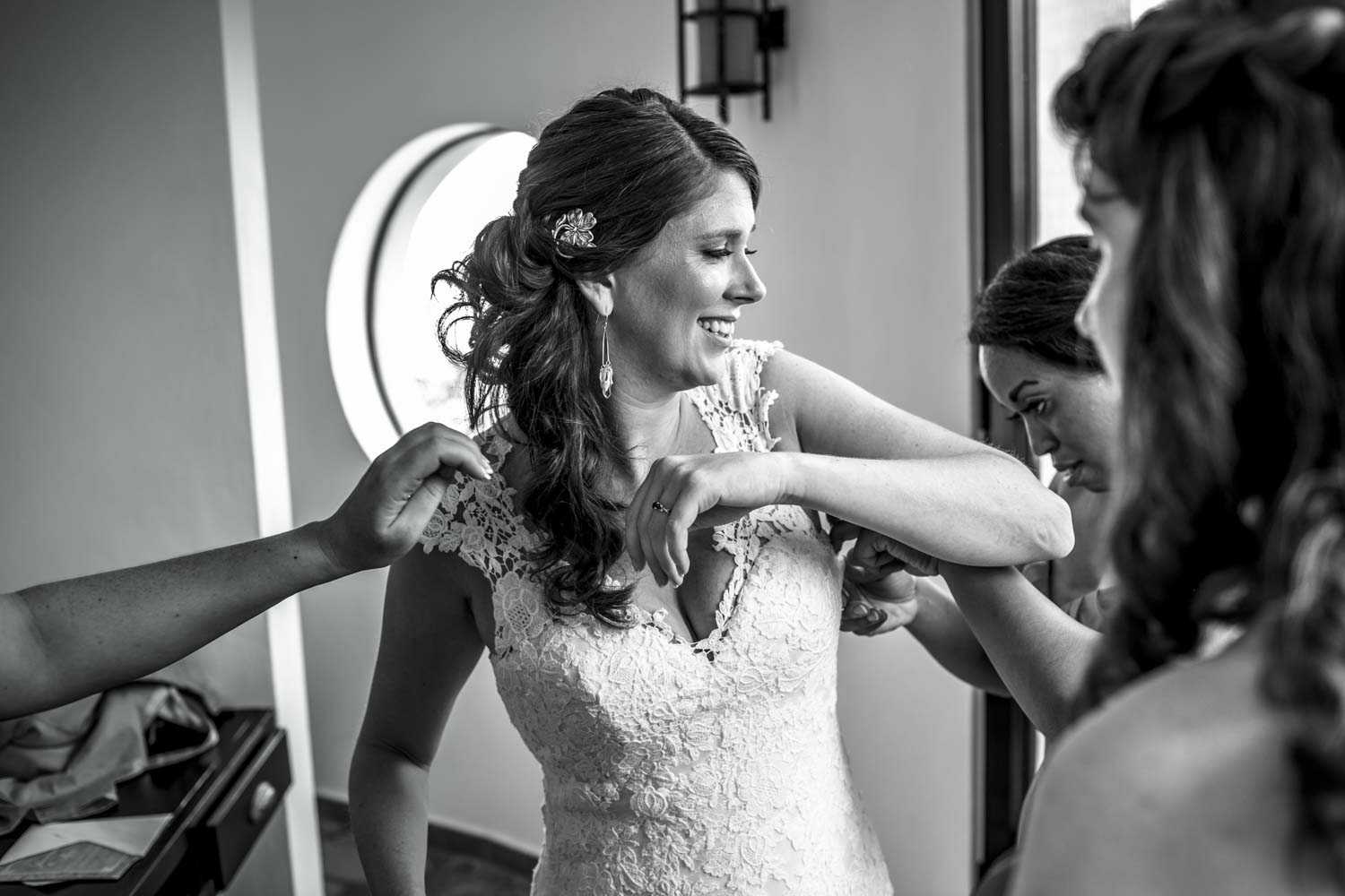 Bride putting on dress in wedding suite at Hotel Magnifico Cabarete Dominican Republic