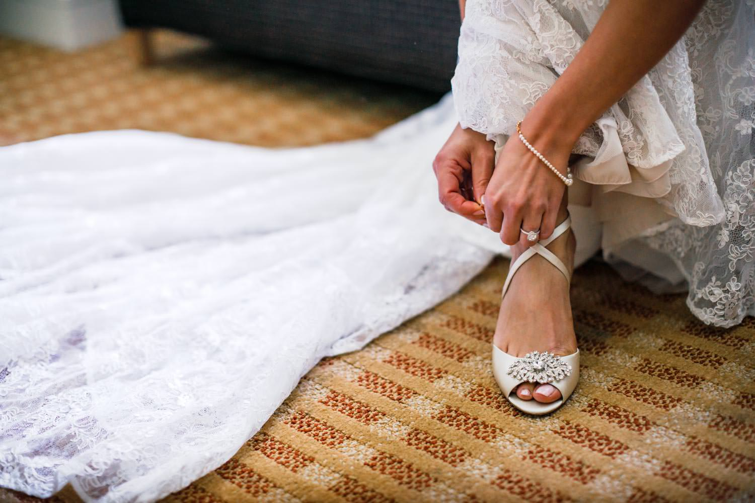 close-up of bride clasping her heals