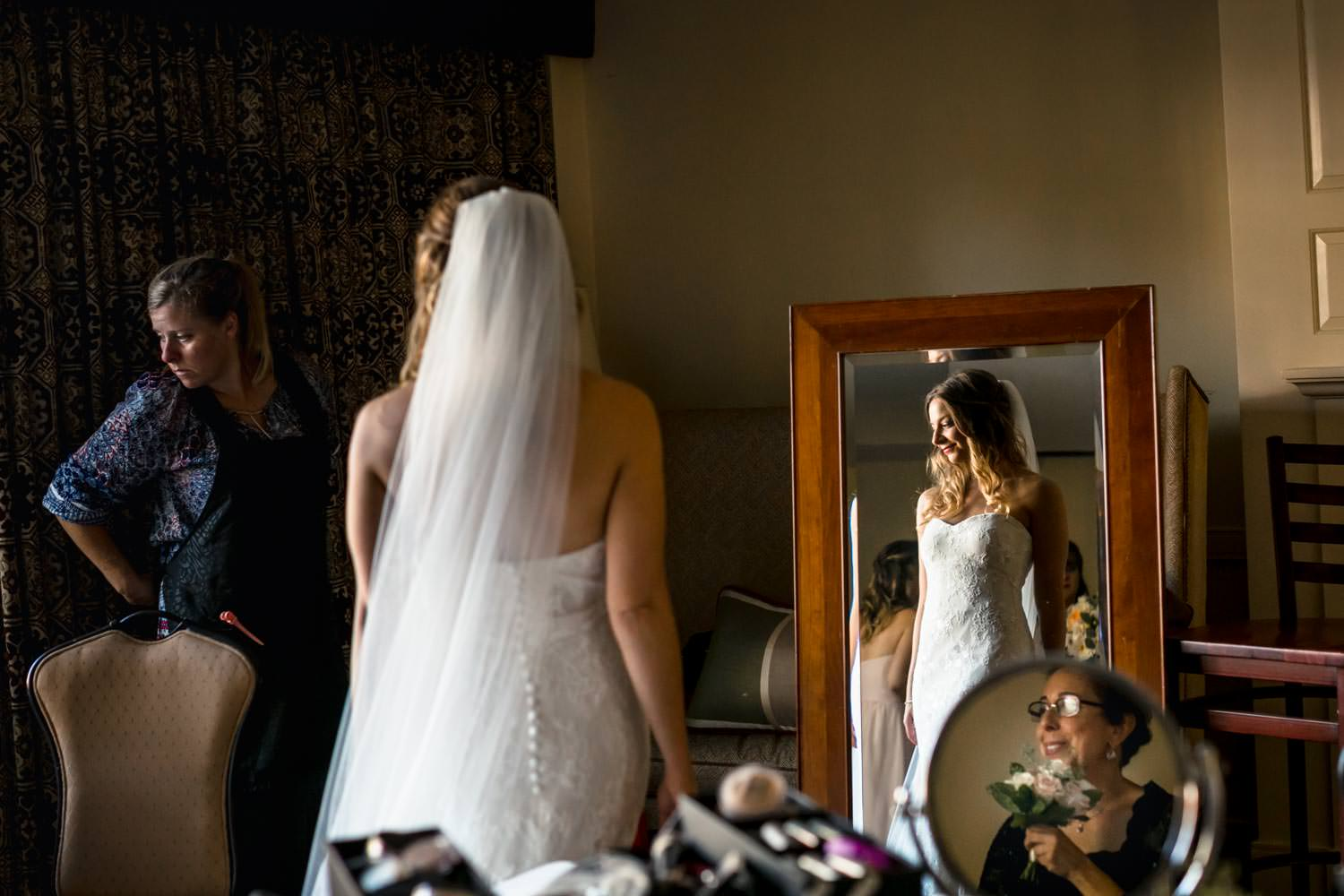 vermont wedding photographer captures bride in mirror with vail