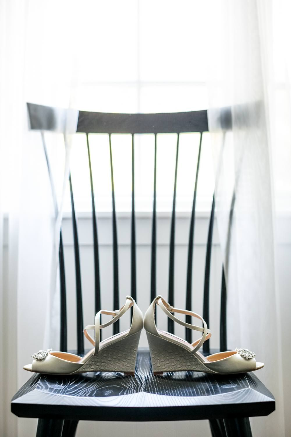brides shoes sitting on chair before wedding at woodstock inn vermont