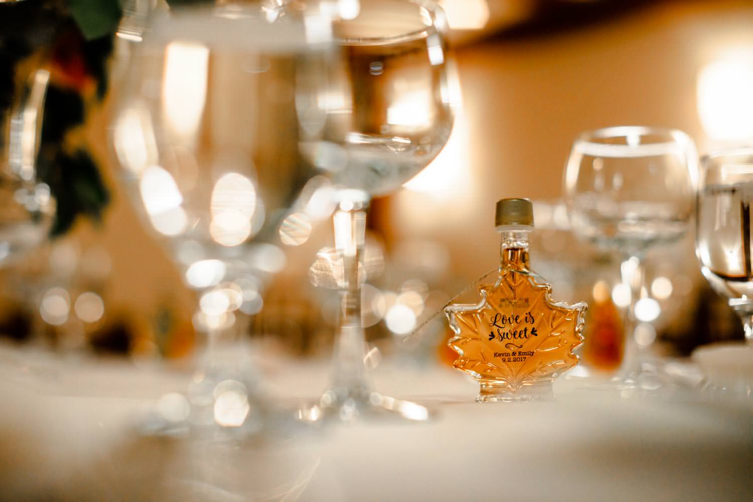 close-up of vermont maple syrup wedding party favor on table of woodstock inn reception