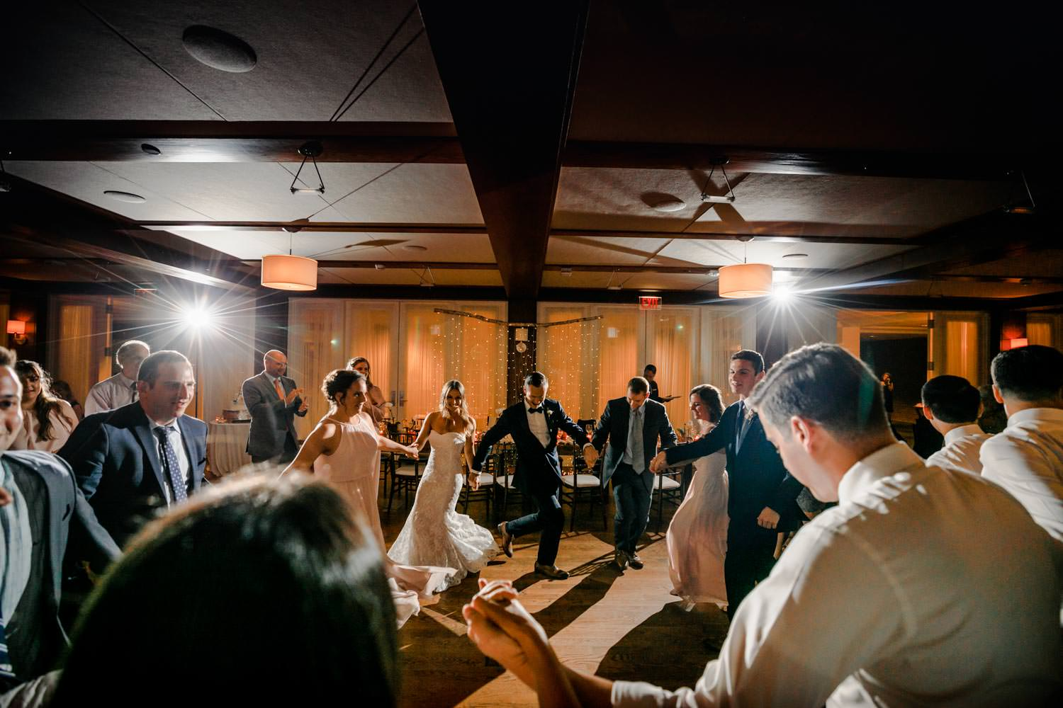 wedding couple dances the hora with guests at the woodstock inn