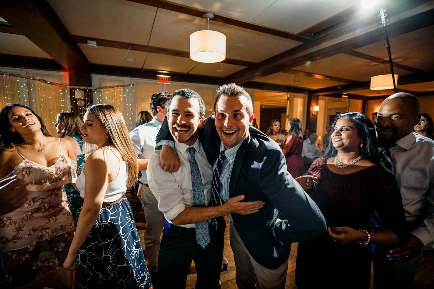 two wedding guests look straight into lens for photographer at the woodstock inn vermont