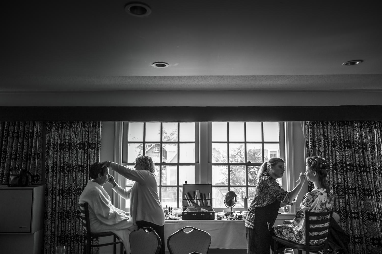 vermont wedding photographer shoots bride and mother getting ready at the woodstock inn